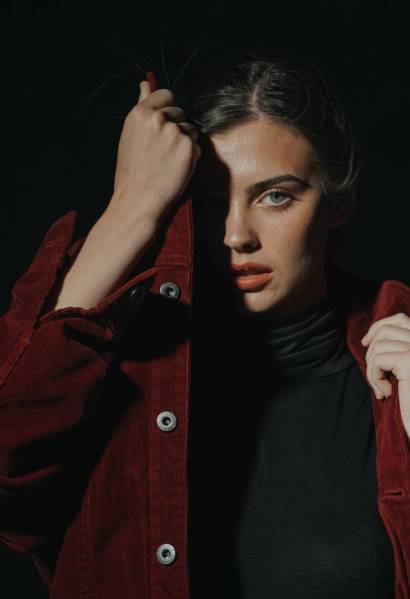 woman in black shirt and red jacket